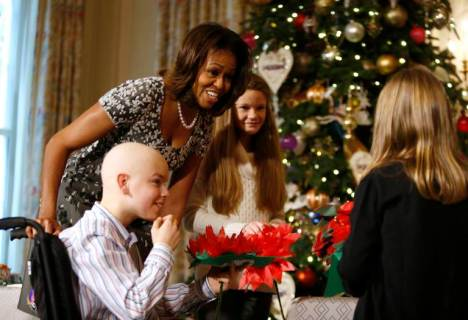 U.S. first lady Michelle Obama meets with the children of U.S. military service members at the unveiling of the Christmas decorations at the White House in Washington, December 4, 2013. REUTERS/Jason Reed (UNITED STATES)
